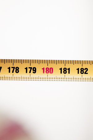 centimeters: Measuring tape metal ruler showing measuement in centimeters (cm) numbers on plain background Stock Photo