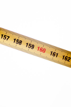centimetres: Measuring tape metal ruler showing measuement in centimeters (cm) numbers on plain background Stock Photo