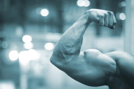 semi nude: Professional champion male bodybuilder muscular man semi nude posing in bodybuilding competition