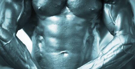 semi nude: Professional champion male bodybuilder muscular man semi nude posing in bodybuilding competition showing abdominal muscles.