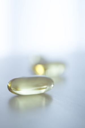 medicate: Cod liver fish oil omega 3 6 9 capsule health food suplement vitamin mineral pill.