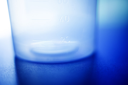 self testing: Urine sample plastic beaker for urine testing for drugs and illness detection photo.