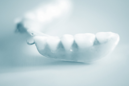 partial: Removable partial denture metal and plastic dental false teeth prosthetics.