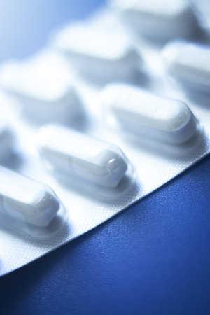 pain killers: Prescription medication drugs photo. White tablets blister pack of medicine pills isolated. Stock Photo