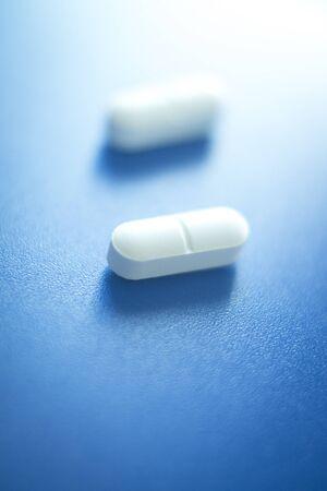 pain killers: Prescription medication drugs photo. White tablets medicine pills isolated. Stock Photo