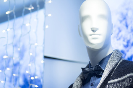 stylish men: Shop dummy fashion mannequin in department store boutique window wearing current casual fashions in clothes. Stock Photo