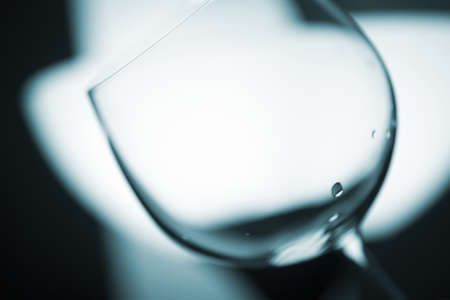glasswear: Wine glass in light at night photo.