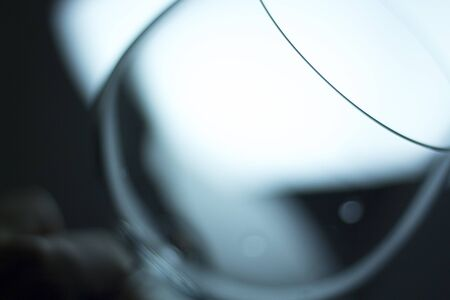 glasswear: Wine glass in light at night photo.