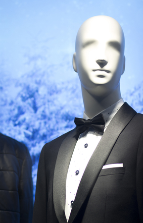 bow window: Shop dummy fashion mannequin in department store boutique window wearing Shop dummy in evening suit dinner jacket and bow tie. Stock Photo