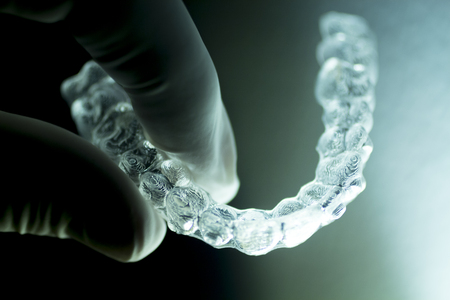 dental: Invisible dental aligners modern tooth brackets transparent teeth braces to straighten teeth in cosmetic dentistry and orthodontics.