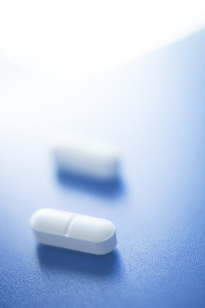 sleeping pills: Prescription medication drugs photo. White tablets medicine pills isolated. Stock Photo