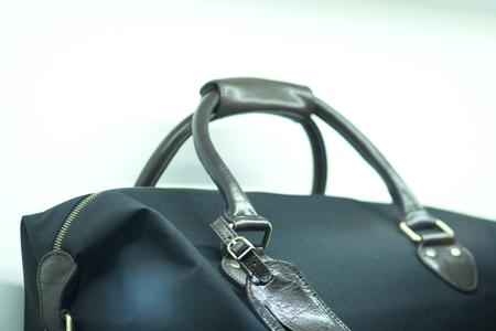 designer bag: Shop window luxury fashion clothes store designer leather handbag.