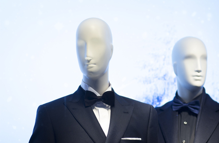 dinner jacket: Shop dummy fashion mannequin in department store boutique window wearing Shop dummy in evening suit dinner jacket and bow tie. Stock Photo
