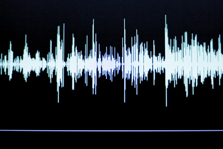 Audio studio digital voice recording voiceover sound wave on computer screen.