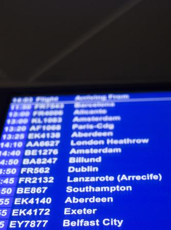 departures: Airport departures arrivals board  light panel board giving information about flights in departure lounge.