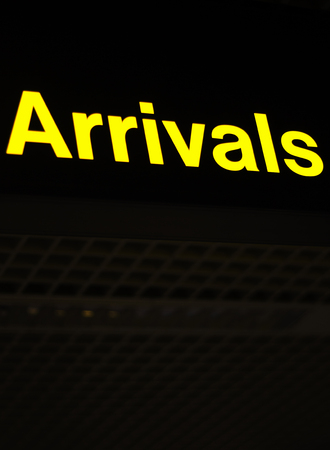 arrivals: Airport information sign light panel giving directions for arrivals lounge for air travelllers. Stock Photo