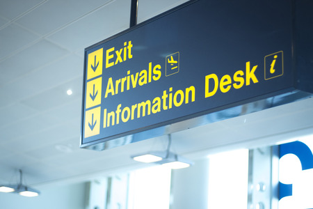 exits: Airport information sign light panel giving directions for exit in departure lounge for air travelllers. Stock Photo