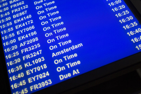 lounges: Airport departures arrivals board  light panel board giving information about flights in departure lounge.