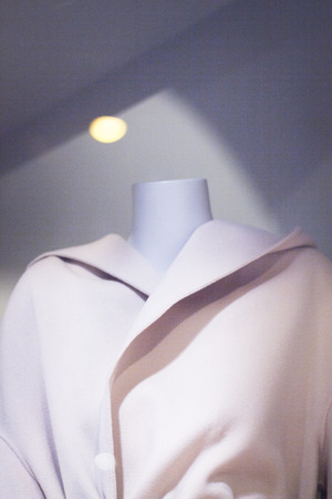 chic woman: Womens clothes fashion store mannequin wearing blouse photo.