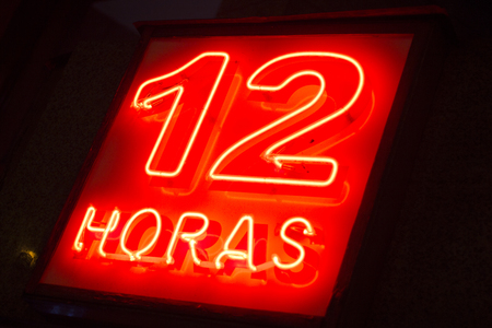 12 hour: Pharmacy neon light chemists 12 hour open sign at night photo.