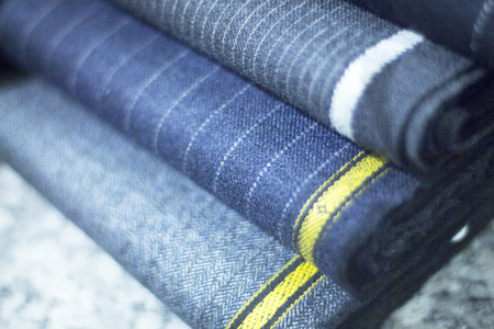 Lamb's wool suit  cloth for meade to measure shirts in tailors retail store window photo.