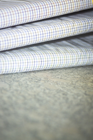 Cotton shirt cloth for meade to measure shirts in tailors retail store window photo.
