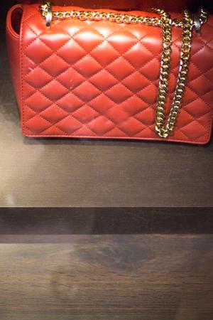 shop window: Shop window luxury fashion clothes store designer leather handbag photograph.