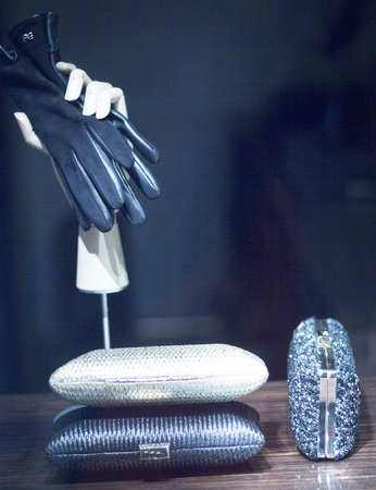 designer bag: Accesories fashion store window display with handbag and glovesphoto.