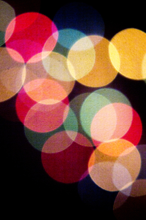 abstract backgrounds: Colored defocused party lights at night abstract photo on black background. Stock Photo