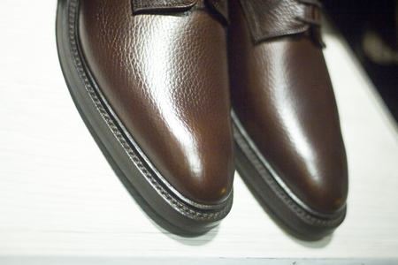 store window: Mens leather luxury hand made formal shoes in store window photograph. Stock Photo