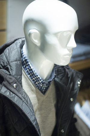 mens fashion: Male man shop dummy mens fashion mannequin in store boutique shop window at night photo. Stock Photo