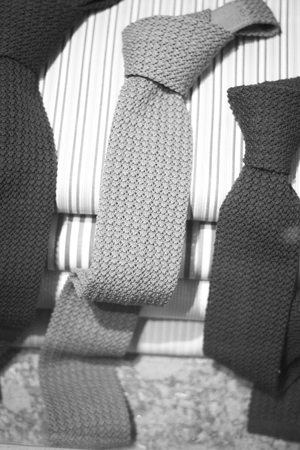 Cotton shirt cloth for meade to measure shirts and ties in tailors retail store window photo.