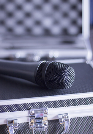Audio recording vocal studio professional microphone and hard metal and foam insert carry case to record singing or voice-overs.