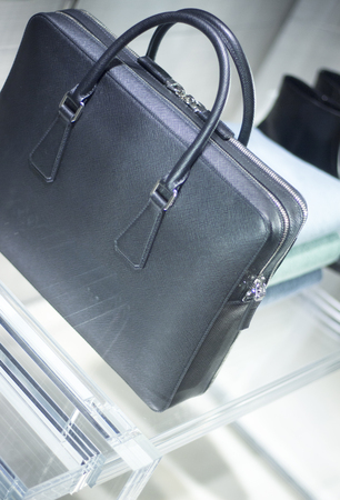 leather briefcase: Store window man bag luxury leather briefcase photo.