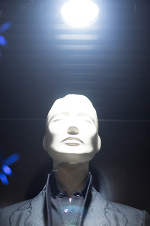 surrealist: Male man shop dummy mens fashion mannequin in store boutique shop window at night photo. Stock Photo