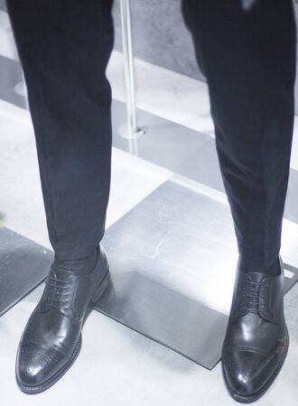 store window: Mens black leather luxury hand made formal shoes on mannequin in store window photo