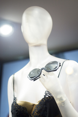 young womens: Womens clothes fashion store mannequin wearing black sunglasses and stylish clothing photo.
