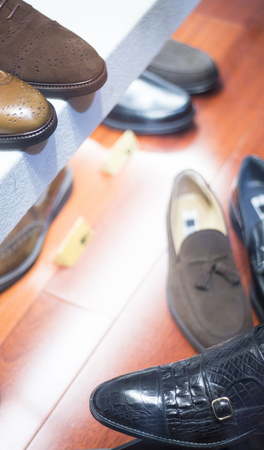 store window: Mens leather luxury hand made formal shoes in store window photo