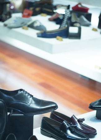 luxury goods: Mens leather luxury hand made formal shoes in store window photo