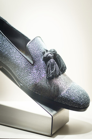 store window: Mens leather luxury hand made formal shoes in store window close-up photo Stock Photo