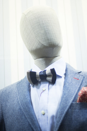 bow window: Male man shop dummy fashion mannequin in store boutique shop window in shirt and bow tie photo.