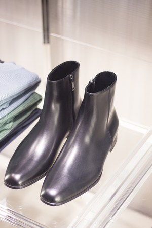 store window: Mens black leather luxury hand made formal shoes in store window photo
