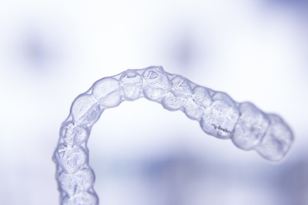 Invisible dental aligners modern tooth brackets transparent teeth retainer braces to straighten teeth in cosmetic dentistry and orthodontics. Banco de Imagens - 49952500