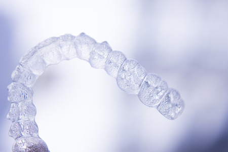 Invisible dental aligners modern tooth brackets transparent teeth retainer braces to straighten teeth in cosmetic dentistry and orthodontics.