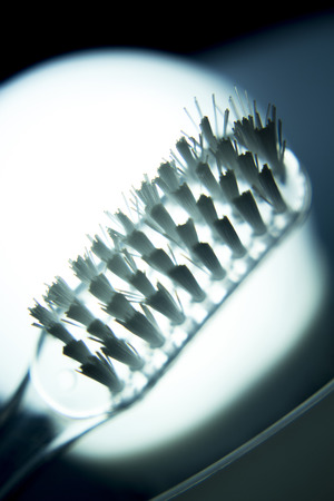 teeth cleaning: Traditional hand dental toothbrush head for teeth cleaning, plaque removal and dental hygiene photo.