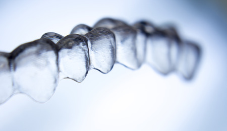 Invisible dental aligners modern tooth brackets transparent teeth braces to straighten teeth in cosmetic dentistry and orthodontics.