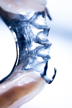 prosthetic equipment: Removable partial denture metal and plastic dental false teeth prosthetic. Stock Photo