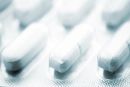 pain killers: Prescription medication drugs photo. White tablet medicine pill isolated blister pack studio shot.