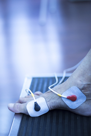 Physiotherapy and orthopedics clinic patient in electrical impulse rehabilitation from Traumatology photo. Stock Photo