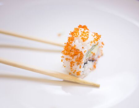 Japanese restaurant sushi oriental raw fish smoked salmon food dish and traditional Asian wooden chopsticks photo. Zdjęcie Seryjne - 53513707